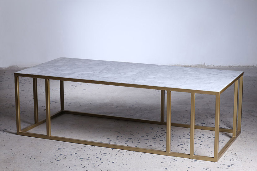 shows rectangle white marble coffee table with gold base